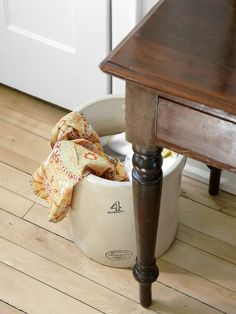 Crock used as laundry drop in kitchen - Sarah Richardson