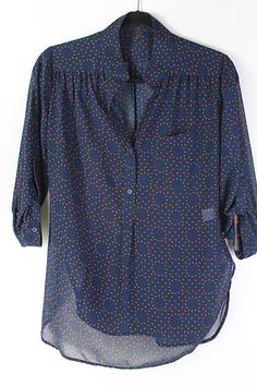 Like navy top with design. Interesting but still not overpowering.