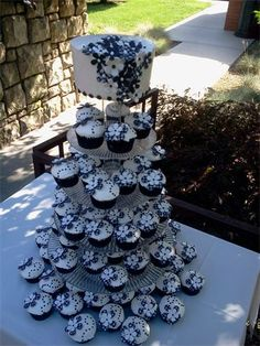 Perfect summer wedding cake, and this baker uses a lavender-blueberry filling that is to DIE for!