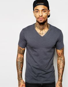 "Muscle fit t-shirt by ASOS Stretch jersey V-neckline Slim cut sleeves Tight fit to the body Skinny fit - cut closely to the body Machine wash 94% Cotton, 6% Elastane Our model wears a size Medium and is 185.5cm/6'1"" tall"