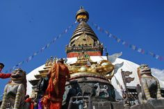 Swayambhunath stupa flanked by two snow lions, with a giant gilded vajra above a mandala worked in a drum-shaped base