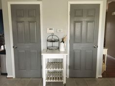 Pantry and basement doors painted in Sherwin Williams Dovetail gray