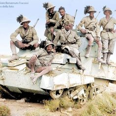 the_ww2_memoirs Italian soldiers belonging to the 7th Reggimento Bersaglieri climb atop and pose for a photo on a disabled British Vickers Mk. VIB light tank, near the port of Tobruk, Libya, 1941. The Bersaglieri was one of the most elite units in the Italian military and also one of the most highly trained yet still under equipped with obsolete weapons. The Bersaglieri mainly got around on motorcycles making them a fast shock attack unit. Their tactics were derived from those of Hutier…
