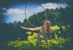 Hannah Stanton-Gockel let's her hoop roll in a field of wildflowers near McArthur, Ohio. She lives in Athens, Ohio, USA. Photo by Brien Vinc...