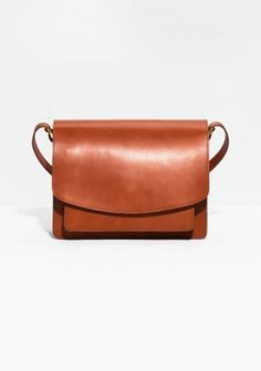 Quality vegatable tanned leather adds longlived authenticity to this structured … Quality vegatable tanned leather adds longlived authenticity to this structured shoulder bag detailed with saddle stitching for a clean and durable finish. Black Leather Bags, Leather Purses, Tan Leather Handbags, Small Leather Bag, Leather Totes, Leather Crossbody, Branded Bags Sale, Side Bags, Orange Bag