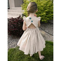This pattern is for a perfect summer dress for the pretty little girl in your life!  The bodice comes with two options: flutter sleeve and faux cap sleeve. It is fully lined for a professional look. The pattern comes with instructions to create a dress length with or without a ruffle, and a maxi length. The best part of this pattern is the back! It features a open back reminiscent of a beautiful tulip. The back is adorable but still modest! The back skirt has an elastic casing to hold it…