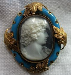 Hardstone, 18 K gold, enamel cameo  of a young man, possibly Antinous Vertumnus, one of the young lovers of the Emperor Hadrian. Made in Italy with an English frame, circa 1876.