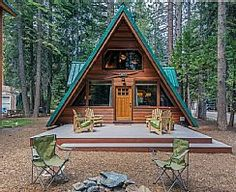 Front of cabin with deck and chairs (firepit removed 2015 due to drought