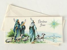 Peaceful pastel blues and greens illuminate this pastoral scene of shepherds on this vintage Christmas holiday card. It wishes receivers