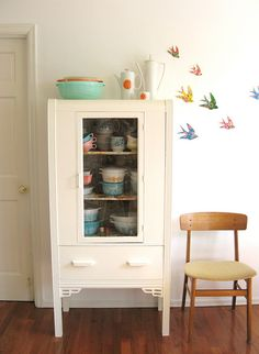 vintage kitchen cabinet with Pyrex collection