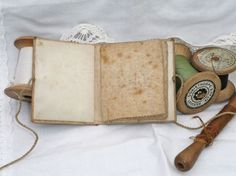 Antique Silk Needlecase via Maude&Mabel Simple, book style needle-book of moire silk, embroidered on front cover.