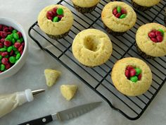 Fill baked cupcakes with candies before icing for sweet surprise