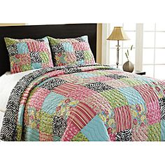 @Overstock - Complete any bedroom decor with this fun reversible quilt set.  This set features a patchwork design on one side a chic zebra pattern on the reverse.  http://www.overstock.com/Bedding-Bath/Zebra-Patchwork-Reversible-King-size-Quilt-Set/5323959/product.html?CID=214117 $148.99