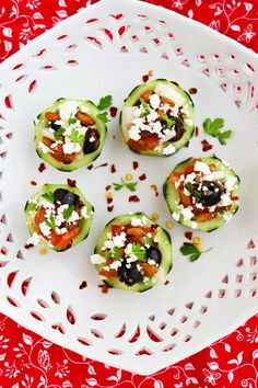 to your very own cucumber cups couldn't be easier. Just peel two cucumbers and leave a few stripes going down the side for an eye-appealing effect. Then, chop them up into 1-inch thick slices, scoop out the insides, and fill to your heart's content.