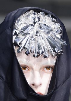 Junya Watanabe SS 2013 Headpiece Detail; SnoWave comment: I wonder what the launch procedure is....blink twice and raise your eyebrows?