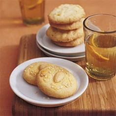 Chinese almond cookies -- Cream 1 c butter & 1 c sugar. Add 1 large egg & 1/2 tsp almond extract. Blend in 2 1/2 c flour & 1 tsp baking powder. Chill dough. Form in balls, flatten. Mix 1 large egg yolk & 1 tbsp milk. Brush tops. Put a blanched whole almonds in center of each. Sprinkle with sesame seeds. Bake at 325 for 15-20 minutes.