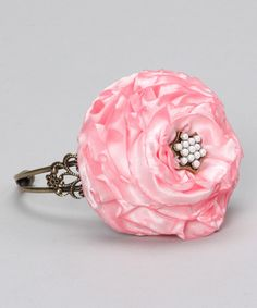 Accent an outfit with this treat for little wrists. A generous floral accent gives it a playfully elegant look that's sure to elevate an ensemble from pleasantly charming to utterly enchanting.Fits ages 13 years and upSatinMade in the USA