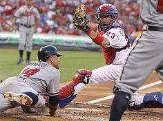 Martin Prado gets under the tag of Phillies catcher Brian Schneider in the third inning on Monday. (Ron Cortes/Staff Photographer)
