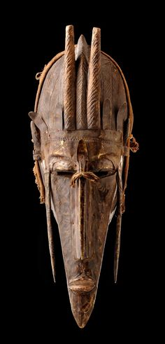 "Mask ""kore"" from the Marka people of Mali. Wood, dark brown patina, oval hollowed base, carved with a narrow face with elongated chin, crowned by vertical protruding horns. Africa Tattoos, Afrique Art, Art Tribal, African Sculptures, Art Premier, Art Sculpture, Masks Art, Totems, African Masks"
