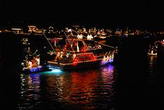 We would sit on a Balboa Island dock, all bundled up and watch the Christmas boat parade every year.