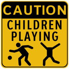 Road sign in Asia...evidently they have children with no heads....or children play with other children s heads