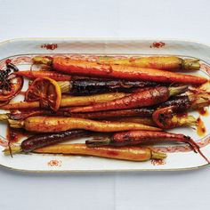 Harissa and maple roasted carrots Bon Appetit  A colorful and spicy (but not fiery!) side breaks up all the heavy, rich dishes on the table.