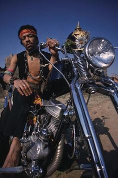Jimi Hendrix photographed on a Harley chopper used as the cover for the compilation album called South Saturn Delta.