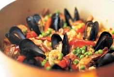 Paella, the classic Spanish dish, is given the full treatment here. You don't need a paella pan to make this paella recipe, either. A Dutch oven will do.