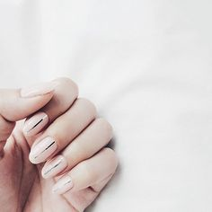 Try these easy-to-master minimal nail art designs from @Stylecaster | nude with metallic center stripe