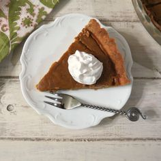 Pumpkin Pie (Dairy Free) - Dairy free, light and creamy pumpkin pie made with coconut milk and spices in a homemade whole wheat pie crust.