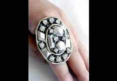 Stretch ring, with two tone metal colors and clear color rhinestones  $14.00