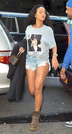Rihanna in Trapvilla paired with a Louis Vuitton bag and Timberland boots our in NYC.