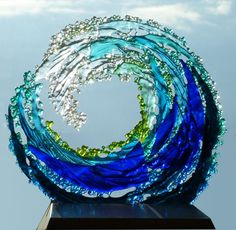 Freestanding tubewave sculpture in wood stand. approx 300mm high. £160