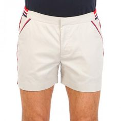 CAVATION BEIGE COTTON WALK SHORTS Cavation beige cotton mid-length walk shorts with two front pockets and two welt back buttoned pockets. Contrast border stripes. Interior metal hook closure and zipper. Contrast ribbed cotton inserts at waistband. COMPOSITION: 100% COTTON. Model wears size 32 he is 189 cm tall and weighs 86 Kg.