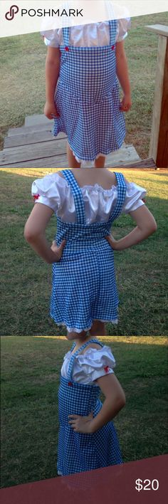 "Rubies ""Dorthy"" costume ADORABLE Dorthy costume 😍 Worn a few hrs last year & then these photos. I spent 50 on it now it's on sale $38. The size says Tween S but my daughter is 7 at sz8 last year and 10 this year •100% polyester interlock knit & satin fabrics •Dress styled to look like blue gingham pinafore over peasant blouse •Blouse portion is satin w/ elasticized neckline •Sleeve cuffs have small red bows •Pinafore blue gingham print •Shoulder straps are anchored w/ red buttons Rubies…"
