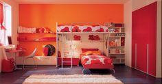 I love the bright orange colors    Kids Bedroom Design by BERLONI