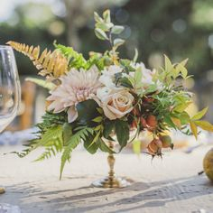 All the booths around the dancing area will have a metallic vintage vase filled with fall foliages and berries, blush dahlias, peachy pink garden roses, lavender spray roses, purple scabiosa flowers, peach ranunculus, fresh lavender, purple astrantia, and plum tulips surrounded by mercury glass votives.