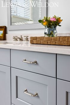 A classic coastal style blue vanity. Paint color is Gull Wing Grey by Benjamin Moore #paintcolor #BenjaminMoore #bathroomvanity #doublevanity #coastalbathroom