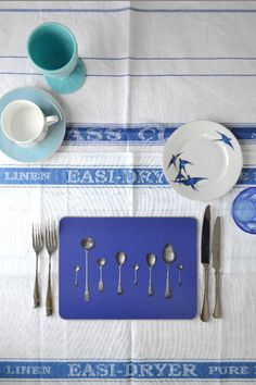 Placemat with Michael Angove's spoon drawings, from www.avenidahome.com