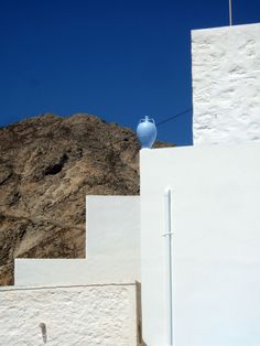 inkdoodles:  Cycladic Geometry This photo is from the Chora in Serifos, one of the most picturesque villages in the Cyclades. There is a reason the first modernists were so struck by the greek islands of the cyclades. It is said that Le Corbusier filled notebooks with sketches from the islands and their architecture. The stark simplicity of the traditional architecture and it's minimal colours, together with the unrelenting bright light of Greece and the barren severe landscape, have a very…