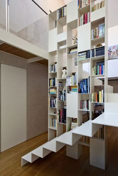 View full picture gallery of Impluvium Home Bookcase Stairs, Bookcase Shelves, House Stairs, Shelving, Bookcases, Staircase Railings, Staircase Design, Stairways, Interior Stairs