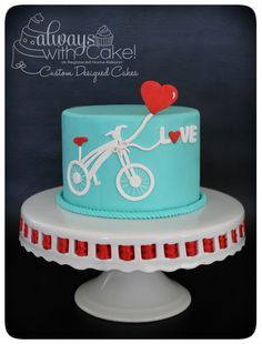 Valentine's Day Bike Ride - Valentine's Day is fast approaching. Loved making this cake. Bicycle and Balloon hand cut out of fondant.
