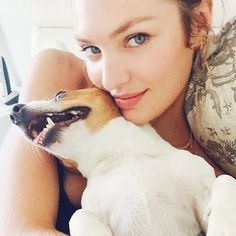 Candice Swanepoel models with dogs