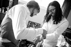 Groomsman helps with the grooms cufflinks as they get ready for a wedding at Alberton House, Mt Albert, Auckland. Black and white. BeSo Studios create beguiling fine art family photographs for the walls of the most discerning clients homes. We specialise in wedding and family portrait photography, and supply prints on the highest quality media, framed in beautiful conservation standard frames. We are a high end studio located in the beautiful city of Auckland, New Zealand.