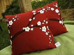 red pillows with white flowers