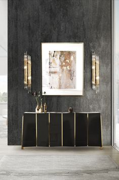 This entryway decor perfectly captures the idea of elegance. Although it has a simple design, the boldness present in the Darian Sideboard, in combination with the golden details of the home decor items and lighting, give this entryway a good sprinkle of personality. And make sure to add artworks to your wall. Black Interior Design, Interior Design Inspiration, Modern Interior, Modern Entryway, Entryway Decor, Uv Lack, Victoria Art, Luxury Lighting, Lighting Design