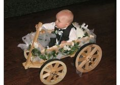 Baby flower girl etc carriage. How cute.