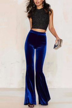 This pants are made in a medium weight deep blue velvet and features high rise fit and super wide bell bottom silhouette. Unlined, side zip closure. Team them up with platforms and a bra top.