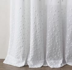 RH Baby & Child's Embroidered Dots Drapery Panel:A cascade of embroidered dots gathers at the hem of our flowing, white, cotton-voile panel.