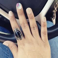 Nude color and a beautiful floral nail wrap